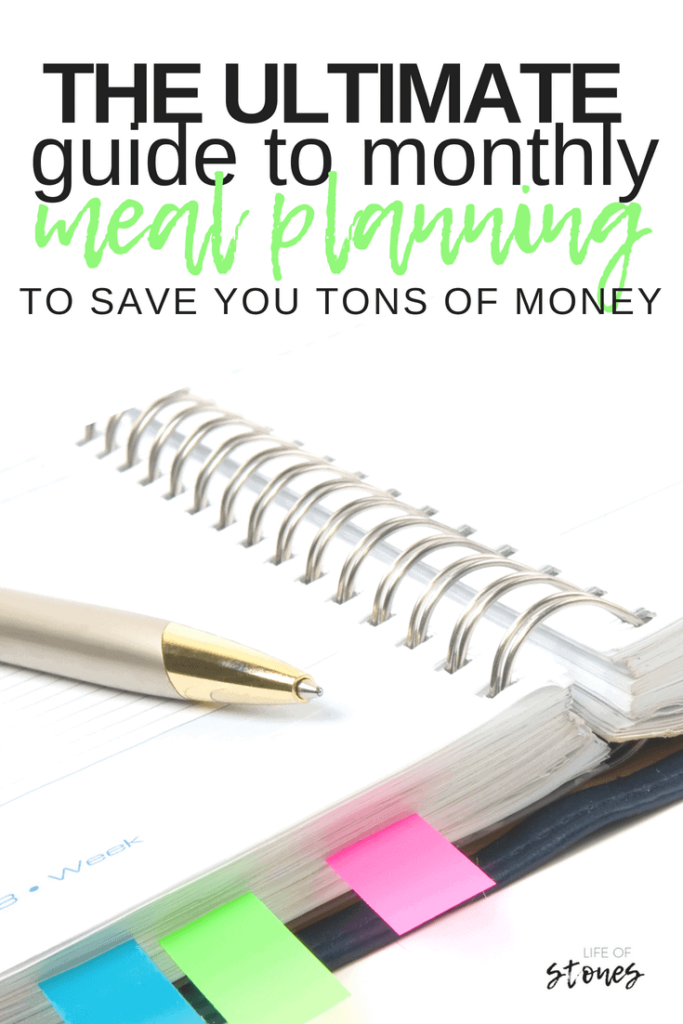 Spiral notebook with colored tabs and a pen with text that reads: The ultimate guide to monthly meal planning to save you tons of money