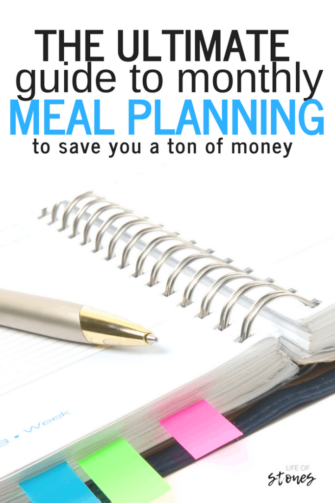 Open notebook with colored tabs and a pen with text that reads: The ultimate guide to monthly meal planning to save you a ton of money
