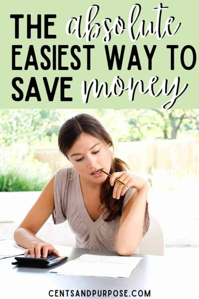 Woman sitting with paper and pen in mouth budgeting with text that reads: The absolute easiest way to save money