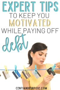 Woman hanging credit cards up on a laundry line with text that reads: Expert tips to keep you motivated while paying off debt