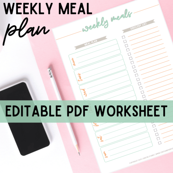 Weekly Meal planner printable on pink table with white pen and iphone