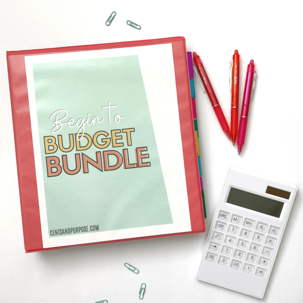Picture of printable budget binder on table with pens and paper clips