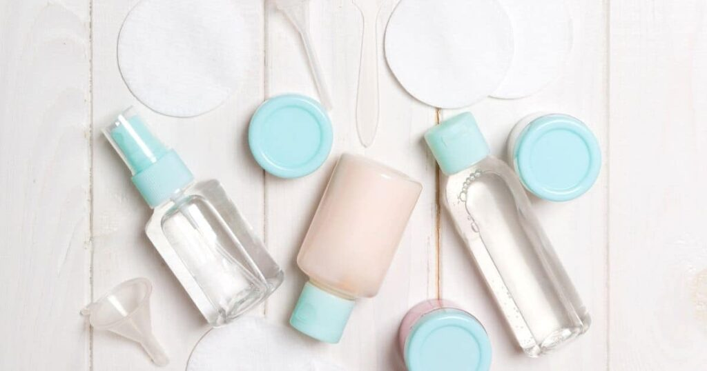 Bottles and beauty products laying on a table