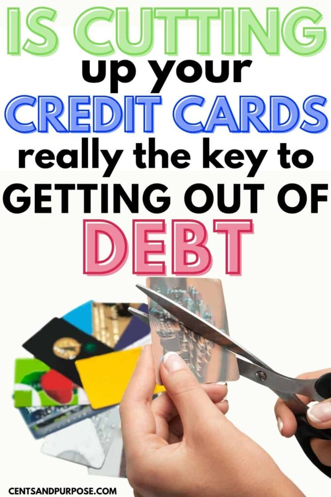 Woman's hands cutting up credit cards with text that reads: Is cutting up your credit cards really the key to getting out of debt